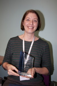 Dr Kate Riney receiving her award at the annual seminar day in Sydney in August 2013